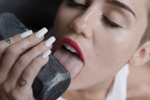 Picture of Miley Cyrus licking a sledgehammer from her Wrecking Ball music Video.